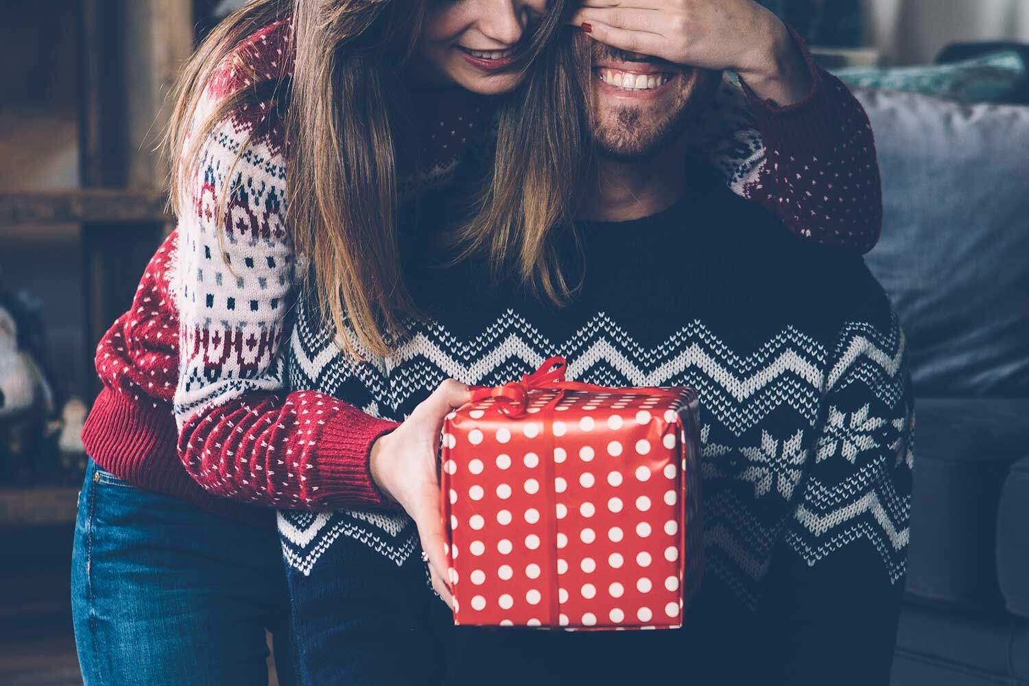 a couple exchanging christmas gifts