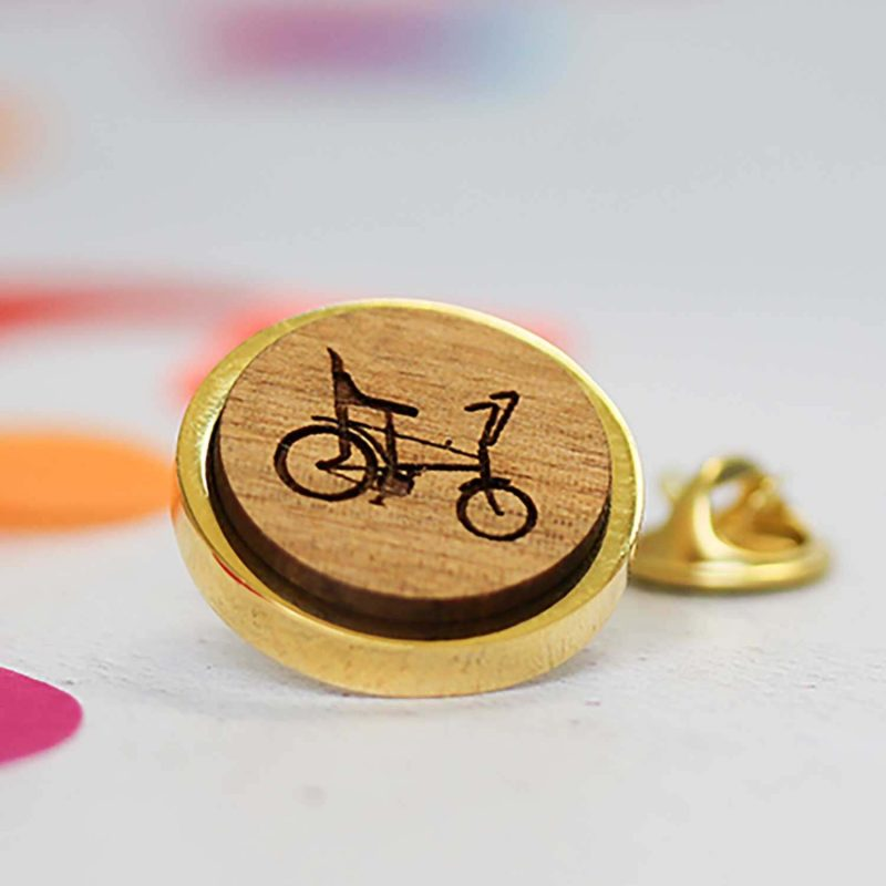 gold chopper pin badge